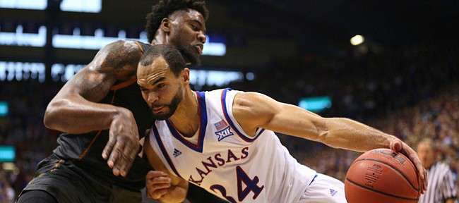 Kansas forward Perry Ellis (34) bangs into Texas center Prince Ibeh as he heads to the bucket during the second half, Saturday, Jan. 23, 2016 at Allen Fieldhouse.