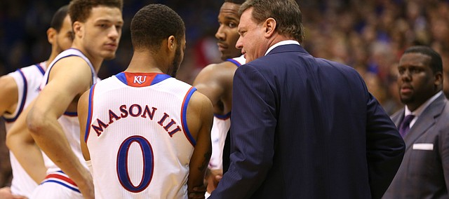 Kansas head coach Bill Self checks on point guard Frank Mason III (0) after Mason went down holding his elbow during the second half, Saturday, Jan. 23, 2016 at Allen Fieldhouse.