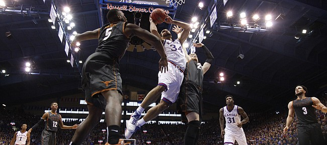 Kansas forward Perry Ellis (34) gets in for a bucket against Texas forward Connor Lammert (21) during the second half, Saturday, Jan. 23, 2016 at Allen Fieldhouse.