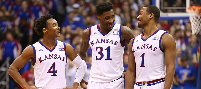 Kansas guard Devonte' Graham (4), forward Jamari Traylor (31) and guard Wayne Selden Jr. (1) have a laugh with the game wrapped up and seconds remaining, Saturday, Jan. 23, 2016 at Allen Fieldhouse.