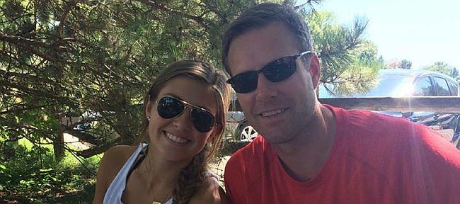 Paige Hoiberg, left, a Kansas University freshman who works in KU's basketball office, poses for a picture with her dad, former Iowa State/current Chicago Bulls coach Fred Hoiberg. Despite ties to both programs, Paige Hoiberg says she'll try to appear neutral when they meet Monday in Ames, Iowa.