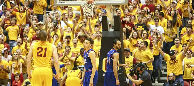 Kansas guard Brannen Greene (14) and forward Perry Ellis (34) stand before a rabid Cyclone student section after a made bucket and foul on Iowa State forward Georges Niang (31) late in the second half, Monday, Jan. 25, 2016 at Hilton Coliseum in Ames, Iowa.