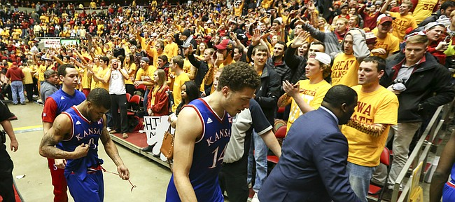 Kansas players Brannen Greene (14), Frank Mason III and Evan Manning leave the court following the Jayhawks' 85-72 loss to Iowa State, Monday, Jan. 25, 2016 at Hilton Coliseum in Ames, Iowa.