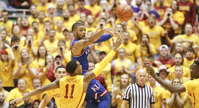 Kansas guard Frank Mason III (0) passes over Iowa State guard Monte Morris (11) during the first half, Monday, Jan. 25, 2016 at Hilton Coliseum in Ames, Iowa.