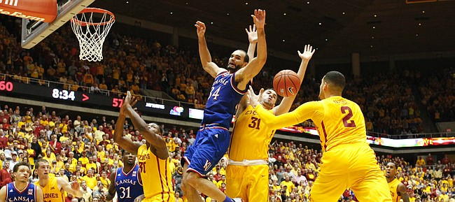 Kansas forward Perry Ellis (34) is stripped of the ball by Iowa State forward Georges Niang (31) and forward Abdel Nader (2) on his way to the bucket during the second half, Monday, Jan. 25, 2016 at Hilton Coliseum in Ames, Iowa.