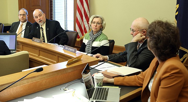 Members of the Senate Corrections and Juvenile Justice Committee led by committee chairman Sen. Greg Smith, R-Overland Park, second from left, sent bills to the Senate floor Tuesday, Jan. 26, 2016, to lessen penalties for marijuana possession and allow individuals with epilepsy to try hemp oil. (Thad Allton/The Topeka Capital-Journal via AP)