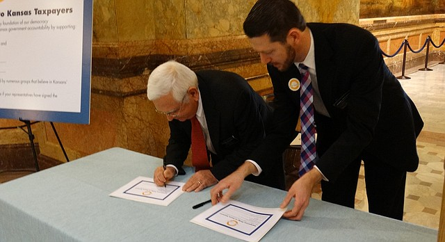 "Reps. John Rubin, left, R-Shawnee, and John Wilson, D-Lawrence, are the first two lawmakers to sign a ""transparency pledge,"" an initiative by open government advocates to bring more transparency to state government."