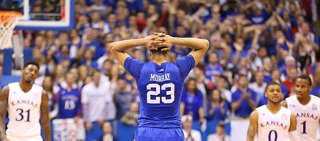 Kentucky guard Jamal Murray (23) holds his head in his hands after Kentucky forward Derek Willis (35) fouled out during overtime, Saturday, Jan. 30, 2016 at Allen Fieldhouse.