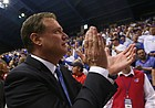 Kansas head coach Bill Self claps as he leaves the court following the Jayhawks' 90-84 win, Saturday, Jan. 30, 2016 at Allen Fieldhouse.