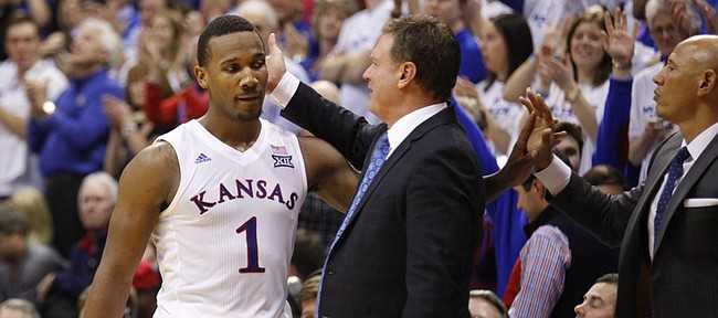 Kansas coach Bill Self gives a congratulatory slap to Kansas guard Wayne Selden Jr. (1) as Selden leaves the game with little time remaining, Saturday, Jan. 30, 2016 at Allen Fieldhouse.