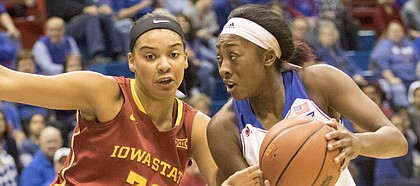 Kansas sophomore Chayla Cheadle, right, looks for a path to the basket around Iowa State's Meredith Burkhall (32)  during their game Tuesday evening at Allen Fieldhouse.