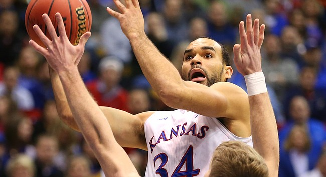 Kansas forward Perry Ellis (34) gets to the bucket over Kansas State forward Dean Wade (32) during the first half on Wednesday, Feb. 3, 2016 at Allen Fieldhouse.
