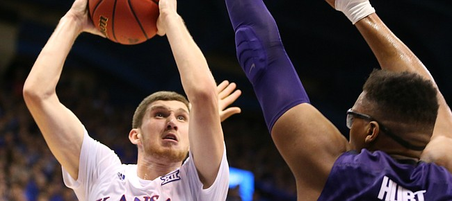 Kansas guard Sviatoslav Mykhailiuk (10) heads up to the bucket against Kansas State forward Stephen Hurt (41) and guard Justin Edwards (14) during the second half on Wednesday, Feb. 3, 2016 at Allen Fieldhouse.