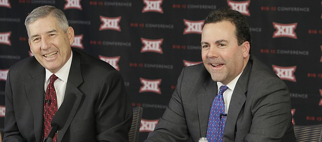 Big 12 commissioner Bob Bowlsby, left, and Kansas athletic director Sheahon Zenger laugh while taking reporter's questions after the first day of the conference's meeting Thursday, Feb. 4, 2016, in Irving, Texas. (AP Photo/LM Otero)