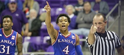 Kansas guard Devonte' Graham (4) signals with an official the ball going the Jayhawks' way after forcing a turnover by TCU guard Chauncey Collins, back, during the second half, Saturday, Feb. 6, 2016 at Schollmaier Arena in Forth Worth, Texas. At left is Kansas forward Jamari Traylor (31).
