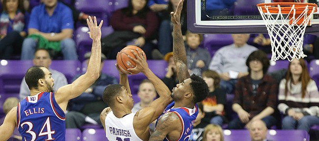 Kansas forward Perry Ellis (34) and forward Jamari Traylor (31) defend against a shot from TCU guard Brandon Parrish (11) during the second half, Saturday, Feb. 6, 2016 at Schollmaier Arena in Forth Worth, Texas.