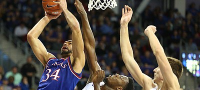 Kansas forward Perry Ellis (34) bangs inside for a bucket against TCU forward JD Miller (15) and forward Vladimir Brodziansky (10) during the second half, Saturday, Feb. 6, 2016 at Schollmaier Arena in Forth Worth, Texas.