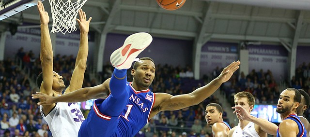 Kansas guard Wayne Selden Jr. (1) and TCU forward Karviar Shepherd (32) get tangled as they fight for a rebound during the first half, Saturday, Feb. 6, 2016 at Schollmaier Arena in Forth Worth, Texas.