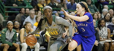 Baylor's Alexis Jones, left, drives against Kansas' Lauren Aldridge. Baylor defeated the Jayhawks, 81-49, in a Big 12 women's basketball game Saturday in Waco, Texas.