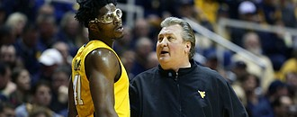 West Virginia head coach Bob Huggins talks to Devin Williams During Saturday's game with Baylor.