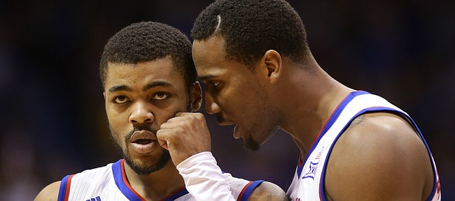 Kansas guard Wayne Selden Jr. tries to pump up Kansas guard Frank Mason III after Mason took an elbow to the face by a West Virginia play during the second half, Tuesday, Jan. 9, 2016 at Allen Fieldhouse.