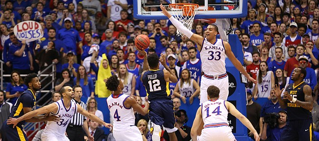 Kansas forward Landen Lucas (33) gets up to defend against a shot from West Virginia guard Tarik Phillip (12) during the first half, Tuesday, Jan. 9, 2016 at Allen Fieldhouse.