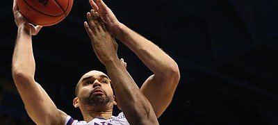 Kansas forward Perry Ellis (34) puts a shot over West Virginia forward Devin Williams (41) during the second half, Tuesday, Jan. 9, 2016 at Allen Fieldhouse.