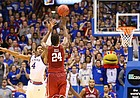Kansas guard Devonte' Graham (4) defends against a three from Oklahoma guard Buddy Hield (24) in triple overtime, Monday, Jan. 4, 2016 at Allen Fieldhouse.