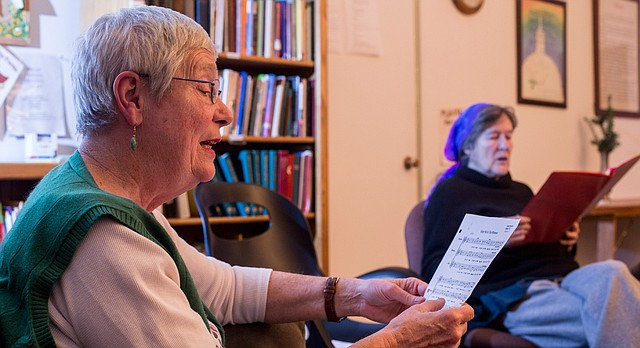 "Jean Drumm, left, and Sophia Compton rehearse ""Keep Me in this Moment"" on Wednesday, Feb. 10, 2016 at Oread Friends Meeting house, 1146 Oregon St. The women are members of the Sunflower Threshold Choir, the Lawrence branch of a nation network of choirs dedicated to singing for those at the threshold of life and death."