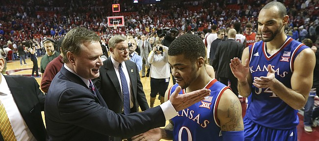 Kansas head coach Bill Self gives a congratulatory slap to Kansas guard Frank Mason III (0) followed by forward Perry Ellis (34) following the Jayhawks' 76-72 win over the Sooners, Saturday, Feb. 13, 2016 at Lloyd Noble Center in Norman, Okla.