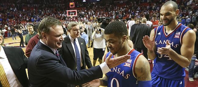 Kansas head coach Bill Self gives a congratulatory slap to Kansas guard Frank Mason III (0) followed by forward Perry Ellis (34) following the Jayhawks' 76-72 win over the Sooners, Saturday, Feb. 13, 2016 at Lloyd Noble Center in Norman, Okla.