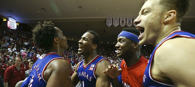 Kansas players from right, Brannen Greene, Carlton Bragg and Wayne Selden come to celebrate with Devonte Graham after Graham held strong late in the game with a few clutch buckets to lift the Jayhawks over the Sooners 76-72, Saturday, Feb. 13, 2016 at Lloyd Noble Center in Norman, Okla.