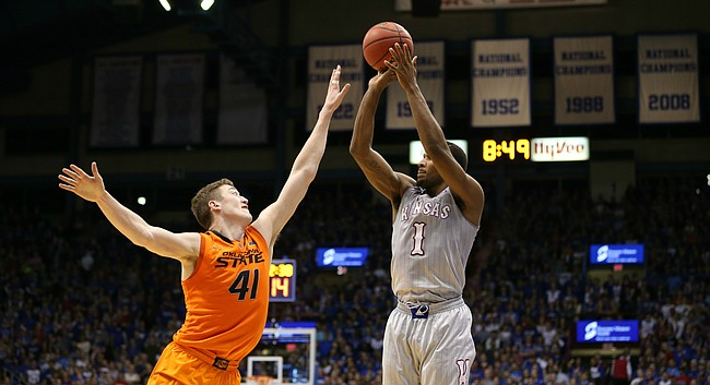 Kansas guard Wayne Selden Jr. (1) shoots a three over Oklahoma State forward Mitchell Solomon (41) during the first half, Monday, Feb. 15, 2016 at Allen Fieldhouse.