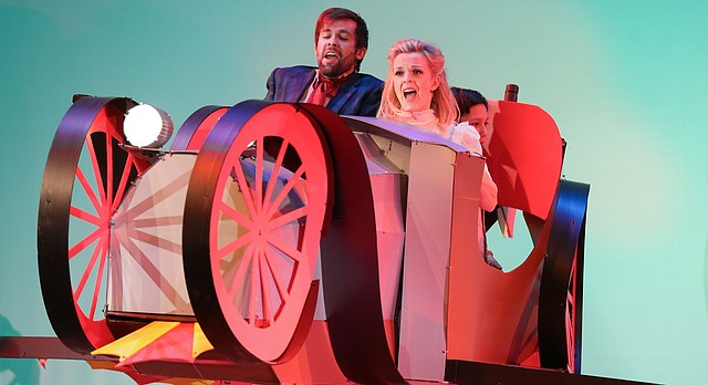 Actors Tom Picasso, playing the part of Caractacus Potts, and Breanna Pine, playing the part of Truly Scrumptious, hold on as Chitty Chitty Bang Bang's wings take them into during a dress rehearsal for Chitty Chitty Bang Bang on Wednesday, Feb. 17, 2016 at the Lawrence Arts Center. The musical, which is directed by Ric Averill, opens Friday at 7:30 p.m.