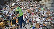 A worker sorts through a large heap of recycling materials for pieces of trash and other larger recycling items, such as a plastic bucket that need to be removed, before being scooped up with a loader and dumped into a complex sorting machine on Wednesday, Feb. 17, 2016 at the Hamm's Recycling Facility, 26195 Linwood Road.