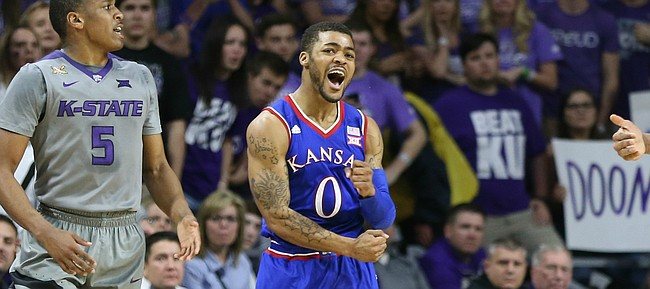 Kansas guard Frank Mason III (0) celebrates after disrupting a pass from Kansas State guard Barry Brown (5) to forward Stephen Hurt (41) for a turnover by the Wildcats during the first half, Saturday, Feb. 20, 2016 at Bramlage Coliseum in Manhattan, Kan.