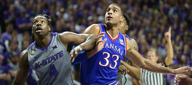 Kansas forward Landen Lucas (33) battles for position with Kansas State forward D.J. Johnson (4) during the first half, Saturday, Feb. 20, 2016 at Bramlage Coliseum in Manhattan, Kan.
