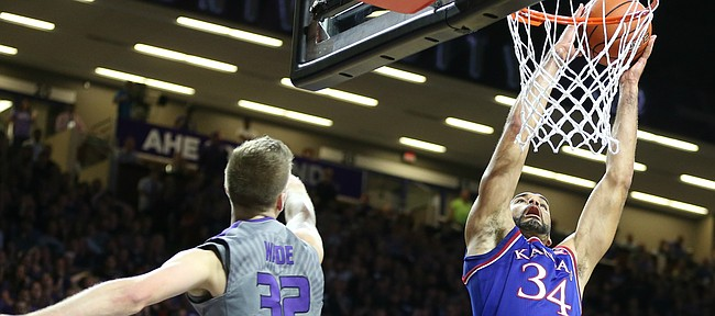 Kansas forward Perry Ellis (34) gets up for a dunk against Kansas State forward Dean Wade (32) during the first half, Saturday, Feb. 20, 2016 at Bramlage Coliseum in Manhattan, Kan.