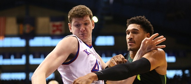 Kansas forward Hunter Mickelson (42) wrestles away a ball from Baylor guard Ishmail Wainright during the second half, Saturday, Jan. 2, 2016 at Allen Fieldhouse.