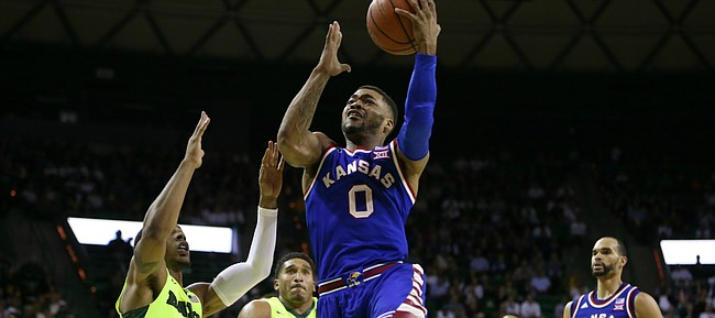 Kansas guard Frank Mason III (0) gets to the bucket past Baylor guard Lester Medford (11) during the second half, Tuesday, Feb. 23, 2016 at Ferrell Center in Waco, Texas.