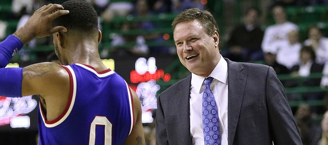 Kansas head coach Bill Self has a laugh with Kansas guard Frank Mason III (0) as time begins to expire in the Jayhawks' 66-60 win over Baylor, Tuesday, Feb. 23, 2016 at Ferrell Center in Waco, Texas.