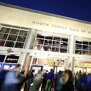 Fans file through the doors of Allen Fieldhouse past the statue of Phog Allen in this file photo from Monday, Oct. 27, 2014.
