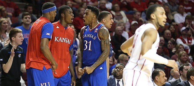 Kansas players Carlton Bragg Jr., Cheick Diallo, and Jamari Traylor celebrate a bucket by the Jayhawks late during the second half, Saturday, Feb. 13, 2016 at Lloyd Noble Center in Norman, Okla.
