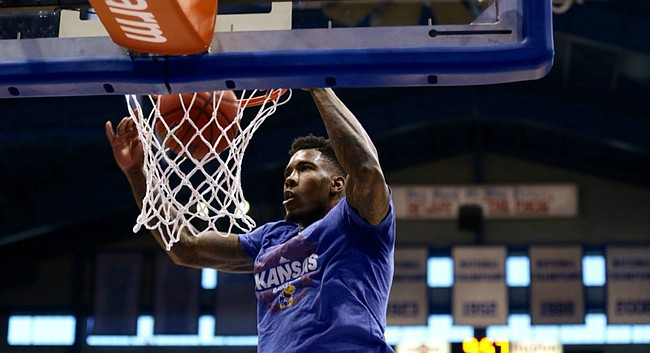 Kansas senior forward Jamari Traylor puts down a dunk during warmups on Feb. 27, 2016, prior to the Jayhawks' game against Texas Tech at Allen Fieldhouse.