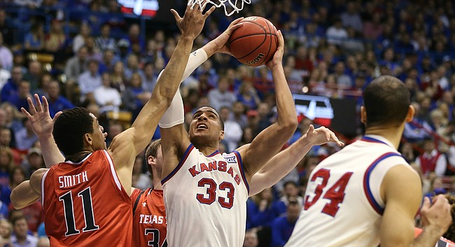 Kansas forward Landen Lucas (33) fights inside for a shot against Texas Tech forward Zach Smith (11) during the first half, Saturday, Feb. 27, 2016 at Allen Fieldhouse.