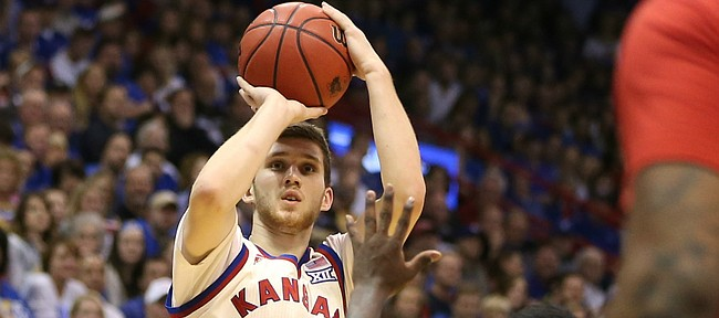 Kansas guard Sviatoslav Mykhailiuk (10) puts up a three over Texas Tech guard Devaugntah Williams (0) during the second half, Saturday, Feb. 27, 2016 at Allen Fieldhouse.