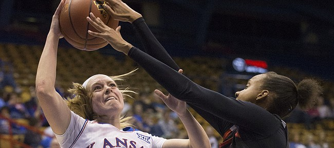 Kansas sophomore Lauren Aldridge (3) is harassed by Texas Tech's Rayven Brooks (11) as she tries to get off a shot during their game Saturday evening at Allen Fieldhouse.