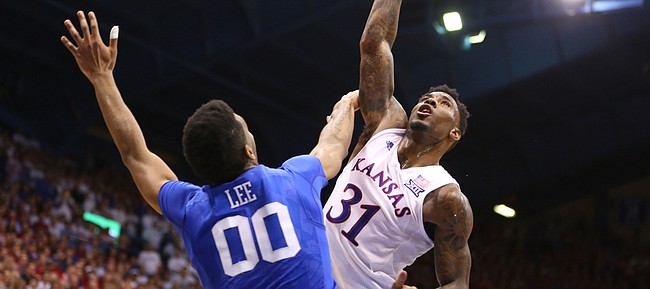 Kansas forward Jamari Traylor (31) hooks a shot over Kentucky forward Marcus Lee (00) for a foul late in the second half, Saturday, Jan. 30, 2016 at Allen Fieldhouse.
