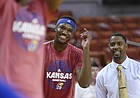 Kansas forward Carlton Bragg Jr. (15), center visits with former KU guard and assistant director of student-athlete developmen, Aaron Miles prior to the start of KU's game against the Texas Longhorns Monday, Feb. 29, 2016 at the Frank Erwin Center in Austin, Texas.