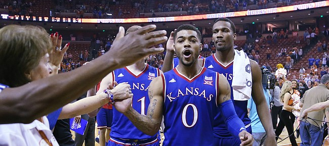 Kansas guard Frank Mason III (0), left and Wayne Selden Jr. right, come off the court after an 86-56 win over the Longhorns Monday, Feb. 29, 2016 at the Frank Erwin Center in Austin, Texas.